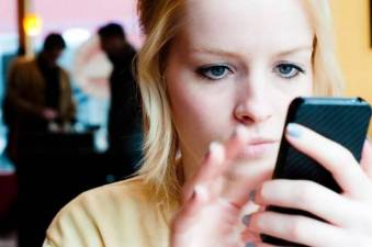woman-using-a-mobile-phone